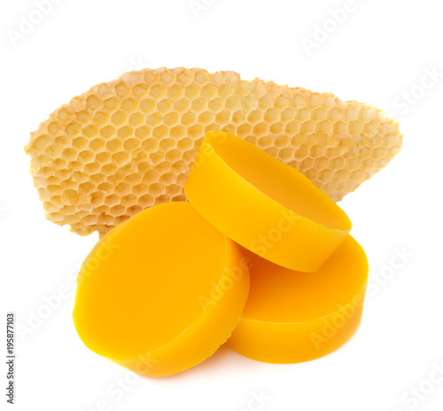 Pieces of natural beeswax and a piece of honey cell are isolated on a white background Canvas Print