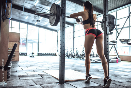 Fotografiet  Sporty woman in gym