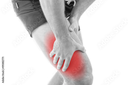 Photo Man with quadriceps pain over white background