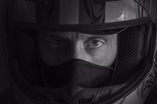 Close Up Portrait Of A Biker In Helmet On Black Background.