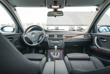 Interior Of BMW E90 Sedan With Recaro Type Seats. Salon With Seats, Electronics, Gauges, Buttons, Steering, Mirrors And Windows. Bayerische Motoren Werke.