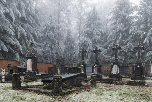 Fototapety, obrazy: Graves with crosses at winter cemetery