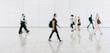 people walking in a modern hall