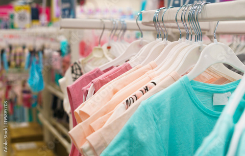 Obraz Children's clothing in the store. Dress for girls - fototapety do salonu