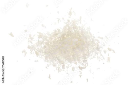 Valokuva  Heap of coconut flakes isolated on white background