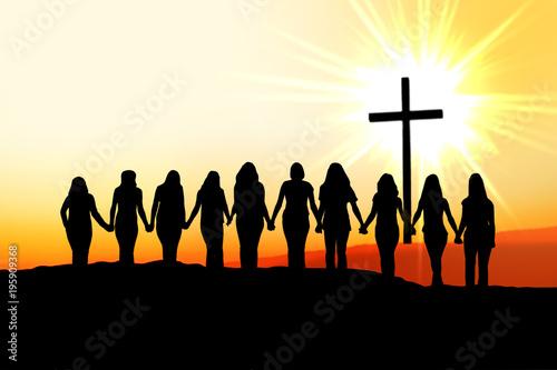 Obraz na plátne Christian women friendship silhouette walking towards the cross in the light