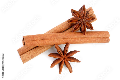 Cinnamon sticks and star anise isolated on white background Wallpaper Mural