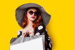 canvas print picture woman in sunglasses with shopping bags