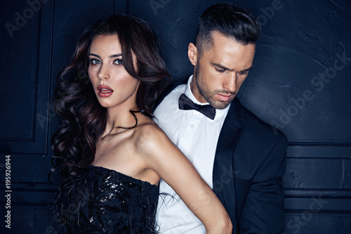 Closeup portrait of an elegant, stylish young couple