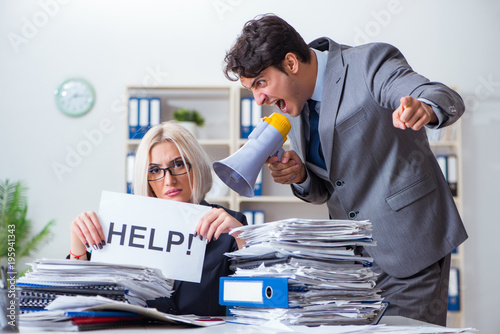 Fotografie, Obraz  Angry boss yelling at his assistant secretary