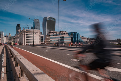 Photo  Cyclist speeds across London Bridge towards The City