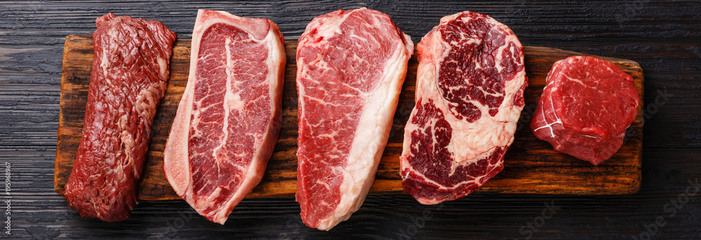 Fototapety, obrazy: Variety of Raw Black Angus Prime meat steaks Machete, Blade on bone, Striploin, Rib eye, Tenderloin fillet mignon on wooden board