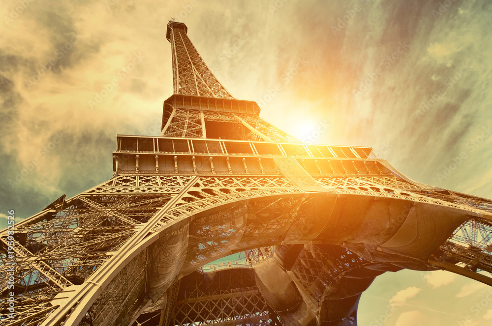 Fototapety, obrazy: The Eiffel tower is one of the most recognizable landmarks in the world under sun light