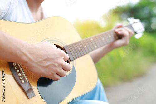 Billede på lærred Guitar player playing song in the nature.