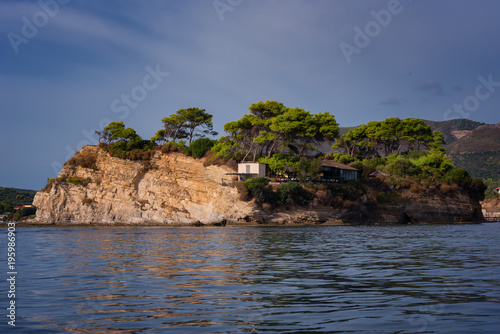 Spoed Foto op Canvas Eiland Sunny summer view of the Cameo Island. Picturesque morning scene in the Port Sostis, Zakynthos (Zante) island, Greece, Europe. Beauty of nature concept background.