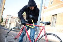 Thief Stealing A Bike In The C...