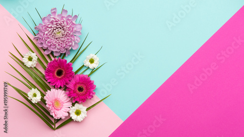 Happy Mother's Day, Women's Day, Valentine's Day or Birthday Pastel Candy Colors Background. Floral flat lay minimal concept.
