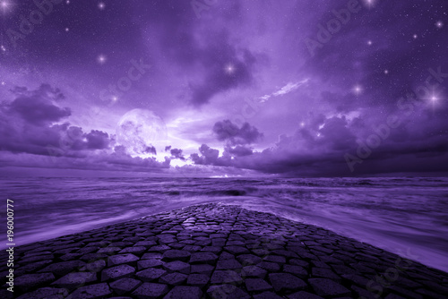 Foto op Plexiglas Snoeien Ultra violet fantasy background, road to the ocean with fantastic night sky, color of the year 2018