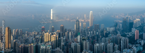 Panoramic Aerial View of Hong Kong Skyline. Victoria Harbour in at Sunny Day.