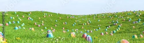 Obraz Bunte Ostereier zu Ostern im Gras einer Wiese - fototapety do salonu