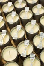 Rows Of White Homemade Candles