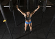 Woman workout with barbell at gym. Crossfit style