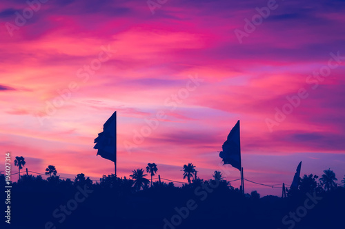 Sunset with flags silhouette, Koh Phangan, Thailand