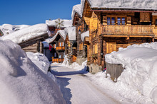 Wooden Houses Or Chalets In Zinal, Switzerland On A Beautiful Day With A Lot Of Snow. Zinal Is A Village In Switzerland, Located In The Municipality Of Anniviers In The Canton Of Valais