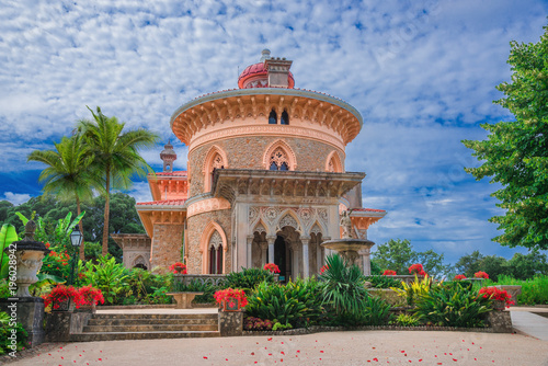 Foto auf Gartenposter Kunstdenkmal Beautiful artistic architecture of Monserrate palace of Sintra surrounded by colorful flowers in Portugal