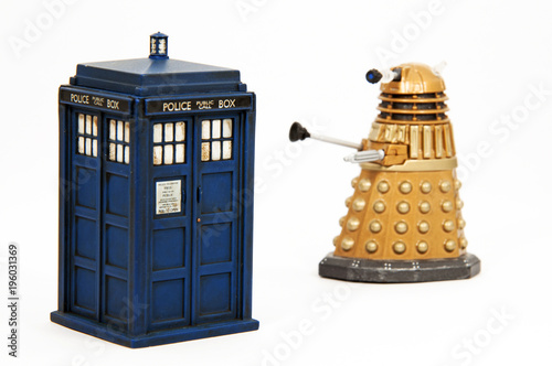 Toy models of a Tardis and Dalek similar to those in the popular TV series Dr Who Poster