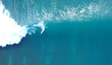 TOP DOWN: Unrecognizable Pro Surfer Riding A Stunning Blue Ocean Wave In The Sun