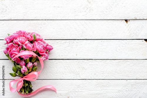 Valokuva  Fresh flowers bouquet, overhead on white wooden background, wedding romantic dec