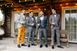 the groom's friends laugh and drink whiskey