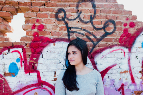 Brunette woman at crown graffiti - Buy this stock photo and explore
