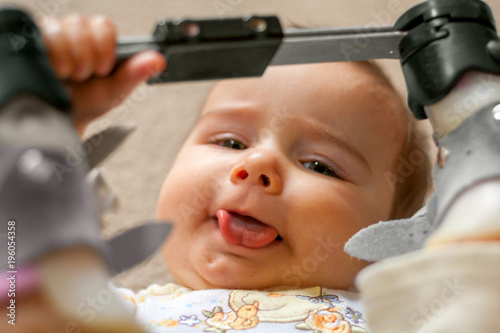 Fotografie, Obraz  Happy Baby with Tongue Tie and Orthopedic Shoes