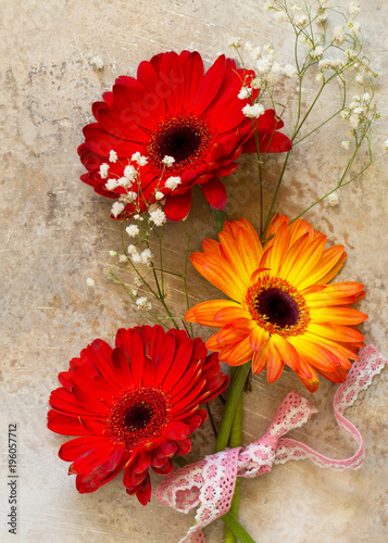 A bouquet of gerbera flower on a stone background or slate with copy space Poster Mural XXL