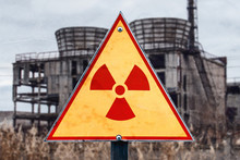 Sign Of Radiation Hazard Against Radioactive Waste On The Building Background, Picture With A Place For Your Text, Copy Space, Your Text Here