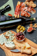 Traditional italian food - prosciutto, cheese, wine, olives and bread