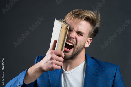 Photo  Man beat face with book, motivation