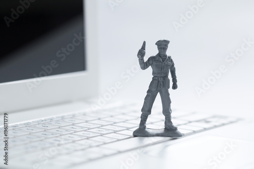 Photo  cyber wars, soldiers on the keyboard