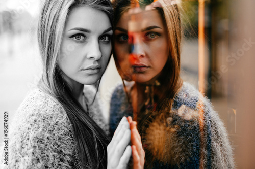 Self reflection portrait of amazing young girl in mirrored window Canvas Print