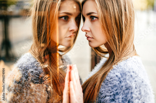 Self reflection portrait of amazing young girl in mirrored window фототапет