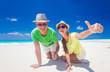 attractive couple enjoying sunny day at Cayo Largo beach, Cuba