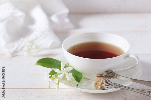 Fotografie, Obraz  Jasmine tea in a white bone china cup on white background