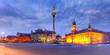 Panorama of Castle Square with Royal Castle, colorful houses and Sigismund Column called Kolumna Zygmunta in Old town during morning blue hour, Warsaw, Poland.