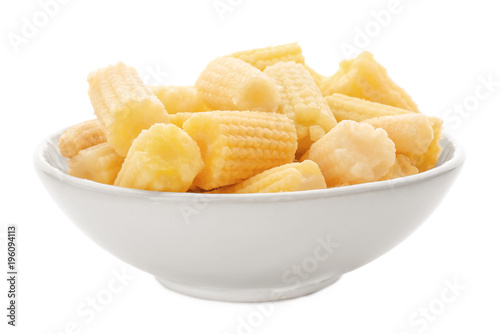 Bowl with cut young baby corn on white background