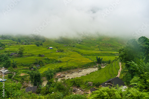 Foto  Picturesque landscape of high mountain village among rice terraces