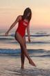 Beautiful model under the sunrise at seaside