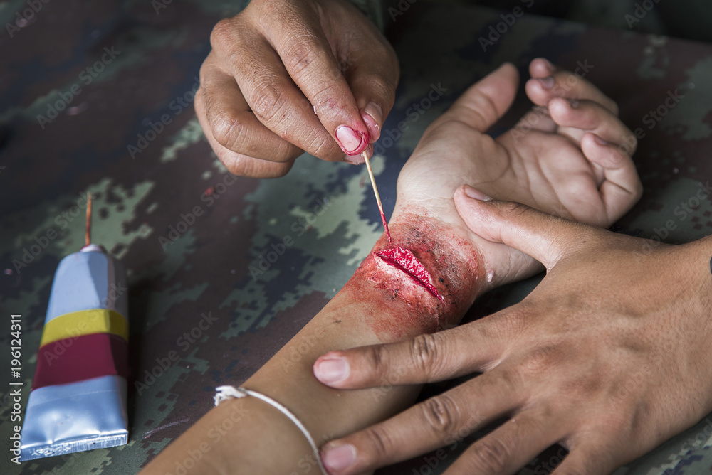 Fototapety, obrazy: make up scar process on hand in war cinema industry