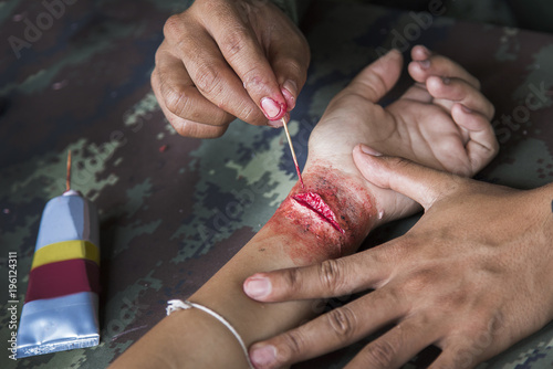 make up scar process on hand in war cinema industry
